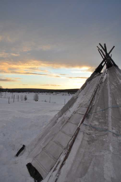 The sun setting behind the Sami tent