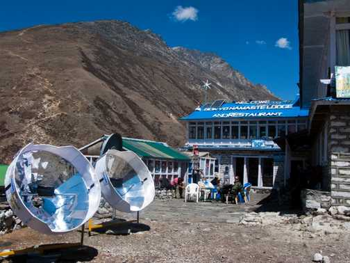 Exodus solar cookers at Gokyo Namaste Lodge, with path up Gokyo Ri in the background