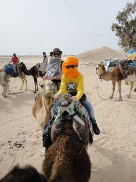 Lili riding out on her camel