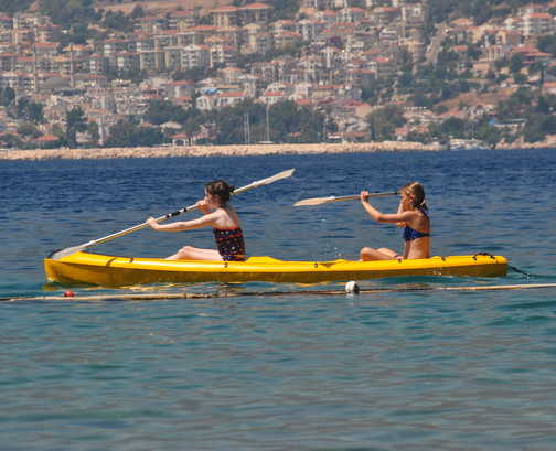 Kayaking together from the beach.