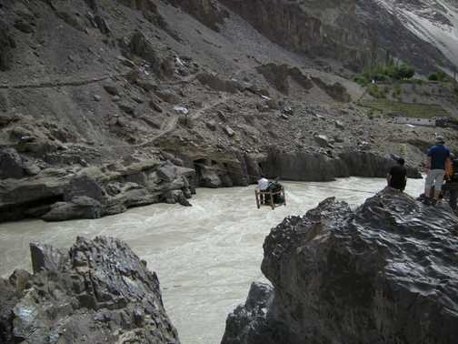 Road was out so we started the trek via a rope traverse over the river.