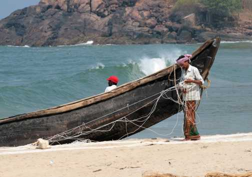 Mending fishing nets at Kovalam, Kerala
