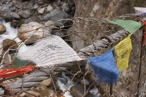 Prayer flags at a river crossing