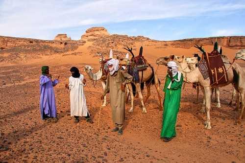 Encounter with a Tuareg caravan in the Acacus Mountains