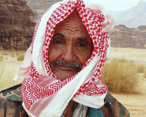 Bedouin at Wadi Rum. I met this old man out walking with his camels in the desert