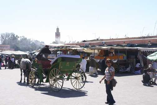 Caleche and orange juicers amidst the madness, Marrakech