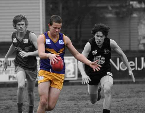 My boy Jesse playing Aussie rules football