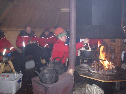 Warming lunch in cosy cabin on dog sled trail