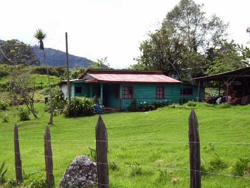 Typical Tico House. Walking down to Copey Village in Central Mountain Range
