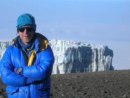 Tom on Crater rim, Ice field close by behind!