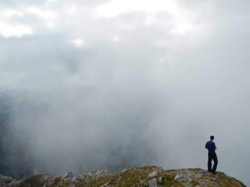 Our guide sneaks off from the summit of Maglic for a cheeky wee.