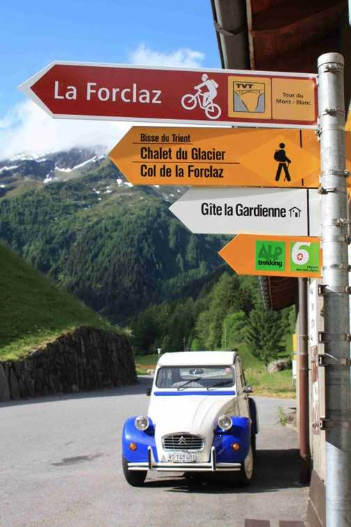 Le Peuty signposts and car