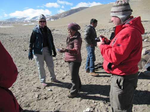 Nomads offering yak butter tea