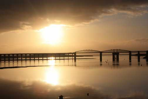sunsets over bridge