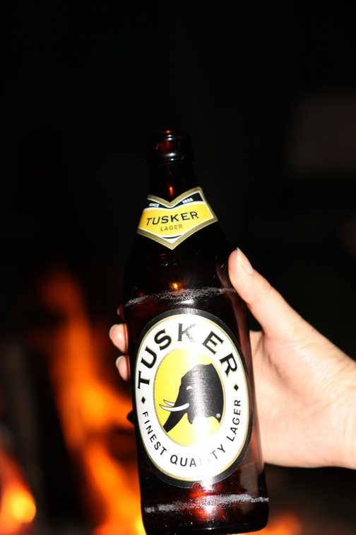 Cold beer and a campfire = happy campers.