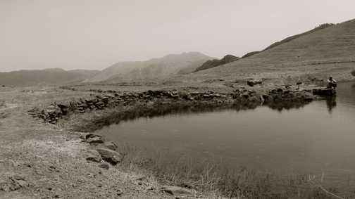 Berber man by a small lake