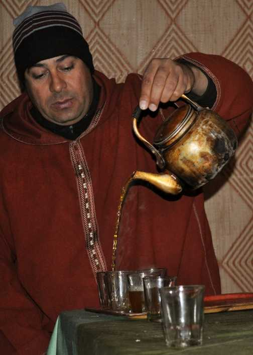 Mustapha pouring our mint tea after dinner