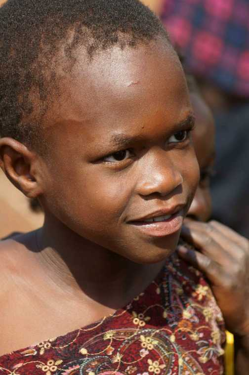 Portrait of young girl snapped while on visit to village near Jinja, Uganda.