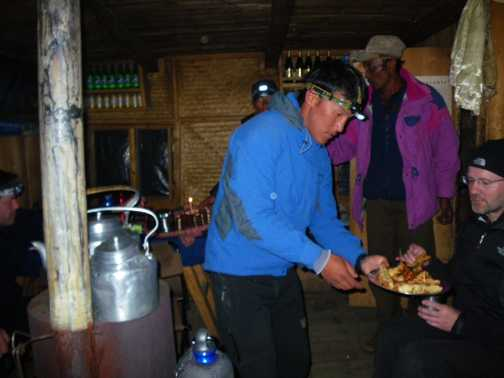 4/4 Tangnag camp (4,300m) - Ngima - our leader on Ron's birthday handing out deep fried mars bars