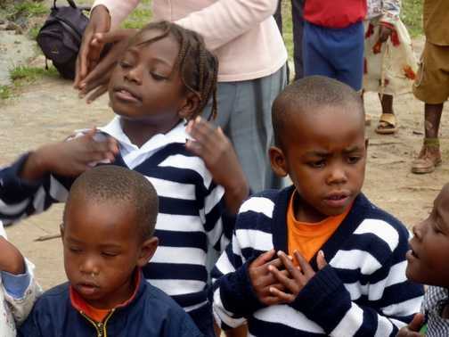 Break time at the orphanage - L Bunyoni
