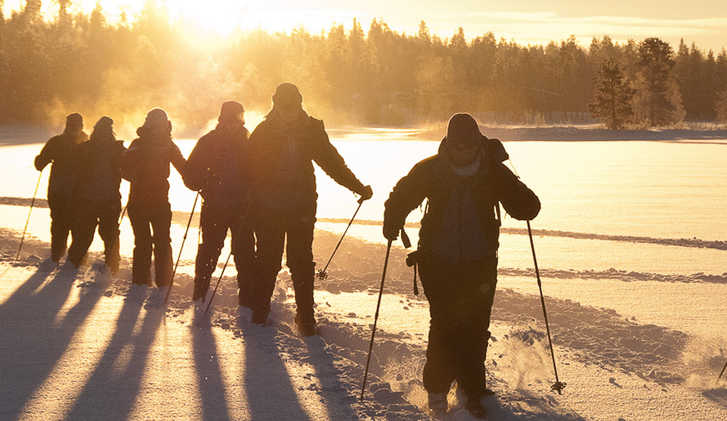 Group snowshoeing in Oulanka NP, Finland