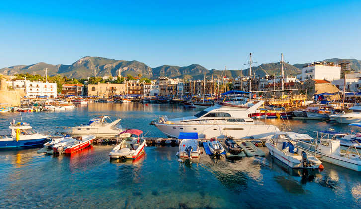Kyrenia (Girne) harbor with castle on the background. Cyprus.