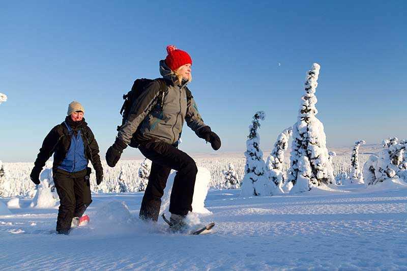 Snowshoeing through a frozen landscape. Riisitunturi National Park, Finland (photo by Erkki Ollila).