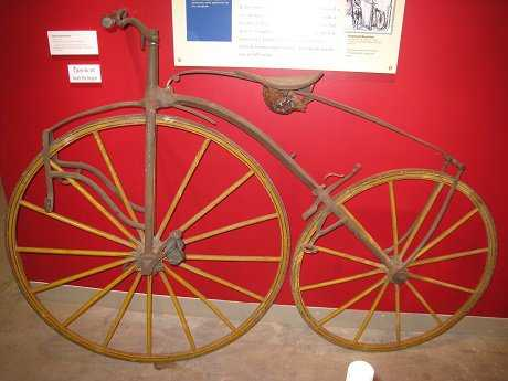 A boneshaker, circa 1868, in a museum. Source: Wikimedia Commons.