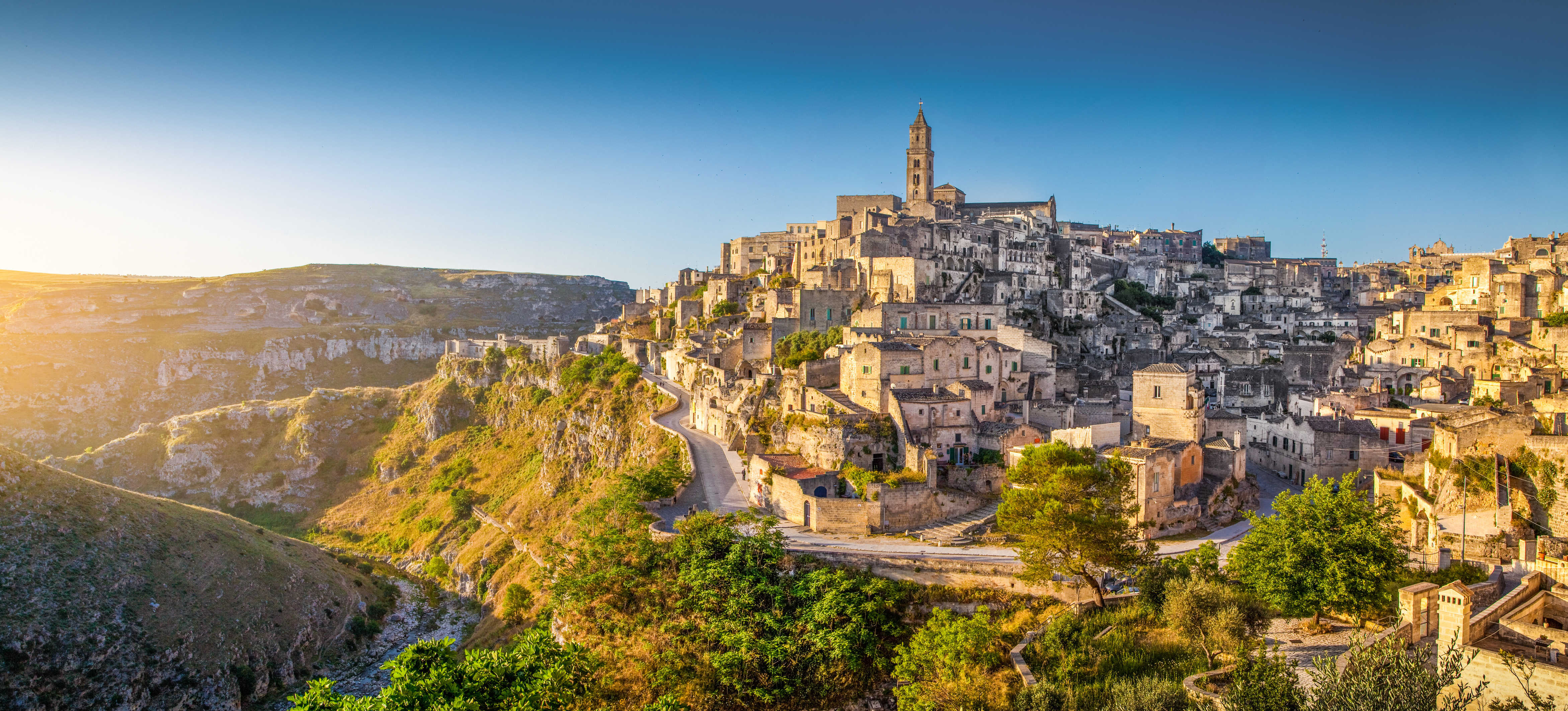 Panoramic view of the ancient town of Matera (Sassi di Matera), European Capital of Culture 2019, at sunrise, Basilicata, southern Italy