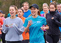 Laura in Exodus shirt at a parkrun event